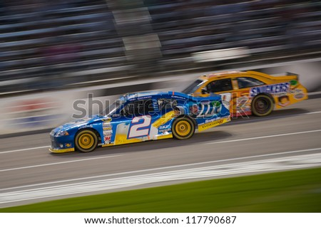 DALLAS, TX - NOVEMBER 04: Brad Keselowski 2 passes Kyle Busch 18 for 2nd place at the Nascar Sprint Cup AAA Texas 500 at Texas Motorspeedway in Dallas, TX on November 04, 2012