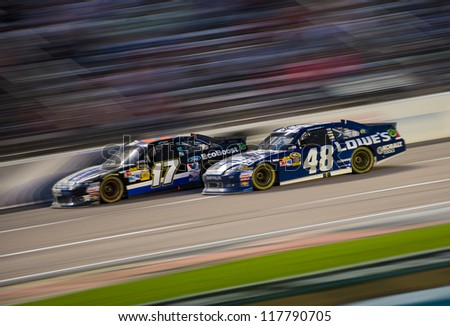 DALLAS, TX - NOVEMBER 04: Jimmie Johnson 48 passing Matt Kenseth 17 at the Nascar Sprint Cup AAA Texas 500 at Texas Motorspeedway in Dallas, TX on November 04, 2012
