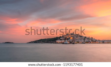 Dalt Vila old town and Ibiza harbour entrance at sunset with red cloudy sky panoramic view . #1193177401