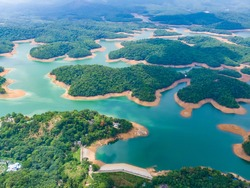 dam lake mountains kerala india turquoise blue water islands forest green pattern beautiful sunny day summer weather drone shot aerial view top angle clouds irrigation