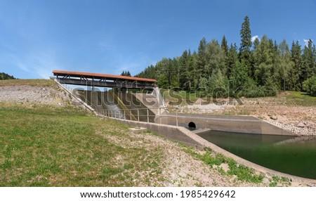Dam Nagoldtalsperre, Black Forest, Germany - overflow with pedestrian bridge at the middle levee Stock fotó ©