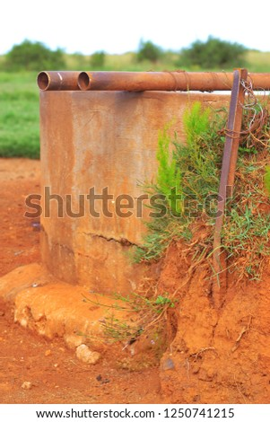 dam with rustic pipes #1250741215