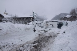 damage and destruction caused by avalanches after heavy snowfall in winter