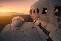 Damaged airplane on mountain against sunset.Solheimasandur Iceland