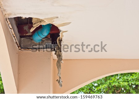 Damaged and leaky ceiling at old abandoned home