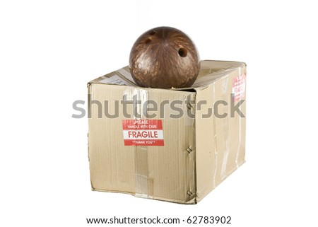 damaged box from bowling ball with the fragile sticker on it, Isolated on white