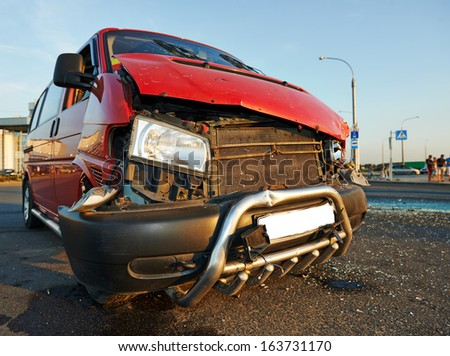 Damaged car vehicle after road crash accident on an urban road