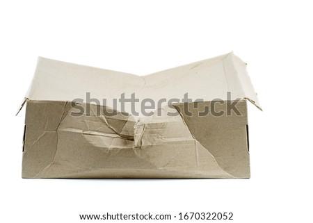 Damaged cardboard box isolated on white background Stockfoto ©