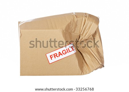 Damaged cardboard box,  isolated on white background - stock photo