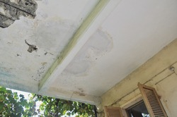damaged concrete slab with water infiltrations and rusted resistance bars
