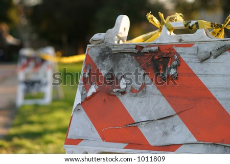 Damaged construction sign in park