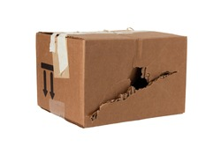 Damaged crumpled postal cardboard box with a punched side and a black big hole. poor delivery of goods