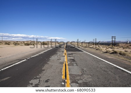 Damaged desert highway in California's harsh Mojave.