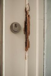 Damaged door frame after a burglary