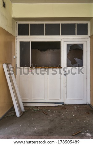 Damaged door in an abandoned hospital