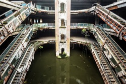 Damaged escalators in abandoned shopping mall building in Bangkok. New World Mall, Apocalyptic and evil concept