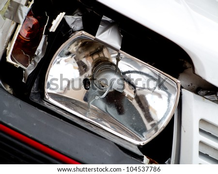Damaged headlight after accident
