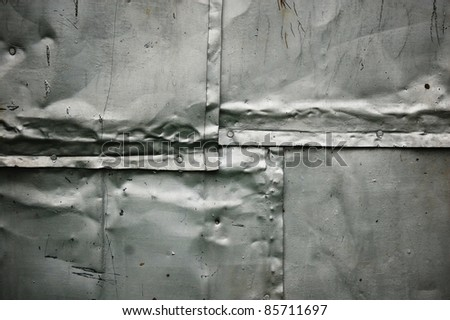 damaged iron  tin, welded joint, grunge metal background