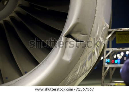 Damaged jet engine on large aircraft