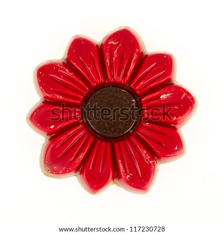 Damaged red chocolate flower, isolated on a white background