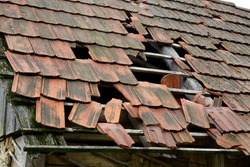 Damaged roof of an old rural house