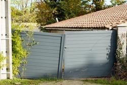 damaged steel gray street gate aluminum broken portal of suburb home