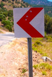 damaged traffic sign with gun