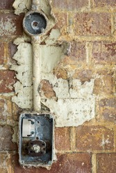 Damaged wall socket in abandoned factory