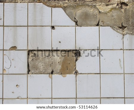 stock-photo-damaged-white-tile-wall-with-some-tiles-missing-53114626.jpg