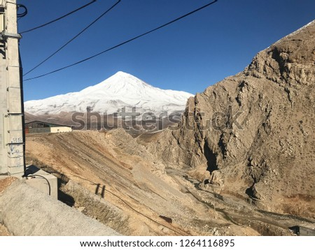 Damavand peak:Damavand Peak, with a height of 5610 meters (18410 feet), is a symbol of Iran, one of the highest peaks in Asia and located in the center of the Alborz Mountains. #1264116895