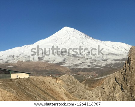 Damavand peak:Damavand Peak, with a height of 5610 meters (18410 feet), is a symbol of Iran, one of the highest peaks in Asia and located in the center of the Alborz Mountains. #1264116907