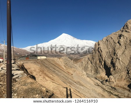 Damavand peak:Damavand Peak, with a height of 5610 meters (18410 feet), is a symbol of Iran, one of the highest peaks in Asia and located in the center of the Alborz Mountains. #1264116910