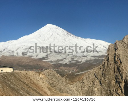 Damavand peak:Damavand Peak, with a height of 5610 meters (18410 feet), is a symbol of Iran, one of the highest peaks in Asia and located in the center of the Alborz Mountains. #1264116916