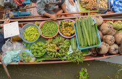 Damnoen Saduak Floating Market or Amphawa. Local people sell fruits, traditional food on boats in canal, Ratchaburi District, Thailand. Famous Asian tourist attraction.