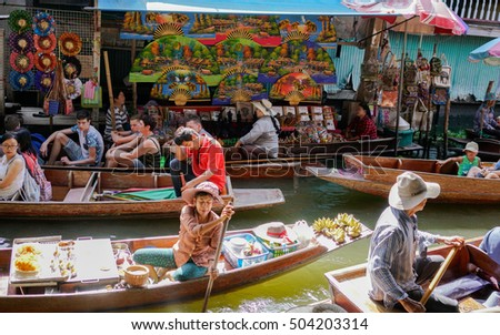 DAMNOEN SADUAK, THAILAND - Aug 18, 2016 - A typical morning floating market activity where local sellers and foreign tourists trade products, mostly souvenirs. #504203314