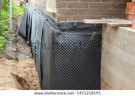 Damp proofing. House basement, foundation insulation details with waterproofing and damp proof membranes, trench with  sand.
