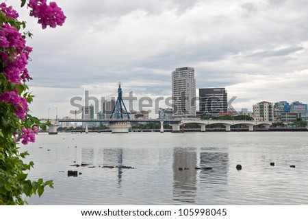 DANANG, VIETNAM - JUNE 17: Buildings on Han River bank on June 17, 2012 in Danang, Vietnam. On January 1, 1997 Danang separated from Quang Nam province to become one of 5 independent municipalities. - stock photo