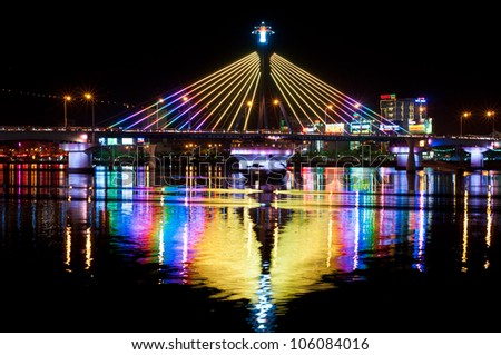 DANANG, VIETNAM - JUNE 17: Han River Bridge on June 17, 2012 in Danang, Vietnam. The Song Han Bridge in Danang is a cable-stayed bridge that is lit up brightly at night.