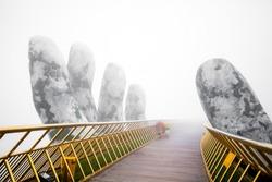 Danang , Vietnam - November 13 ,2018 : View in Fog of the Golden Bridge on Ba Na Hill.