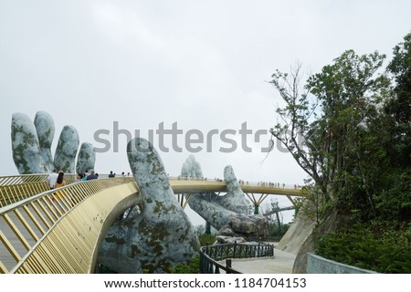 Danang ,Vietnam - September 5,2018 : View of The Golden Bridge is two giant hands on  Ba Na Hill in Danang , Vietnam.  #1184704153