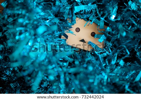 Stock Photo Danbo with tinsel. Christmas and New Year image.