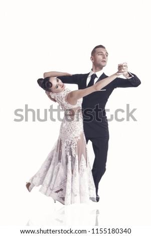 dance couple dance ballroom . beautiful ballroom dance couple in a dance pose isolated on white background. sensual professional dancers dancing walz, tango slowfox and quickstep #1155180340