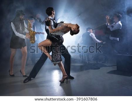 Dance couple dancing ballroom dancing to a live band sounds