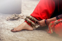 dance form indian classical feet with ghungru.Kathak Girl tying ghungaroo.