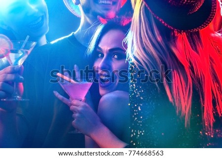 Dance party with group people dancing. How to pick up girls at a club. Women and men have fun in night club. Seduce woman cuddles up guy . Opening of a new strip club.