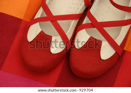 Dance shoes on red cushion