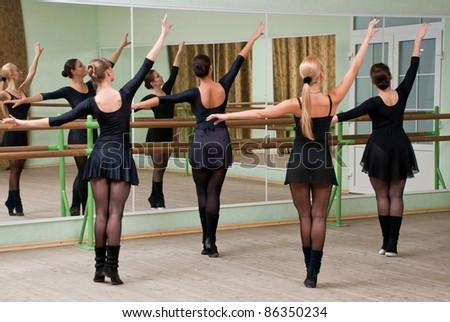 dancer is doing exercises in ballet class - stock photo
