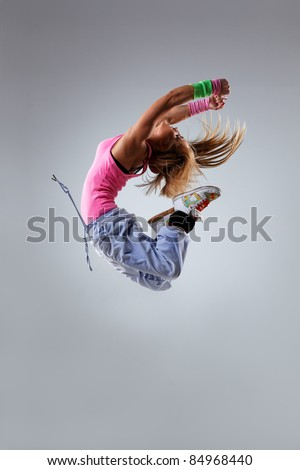 dancer jumping on studio background