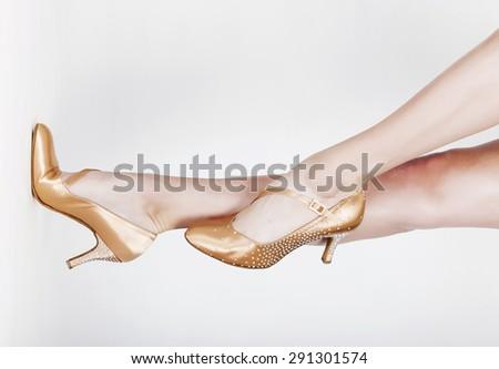 Dancer legs wearing ballet shoes on white background horizontal