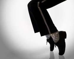 dancer move. standing on the feet fingers in a power freeze move